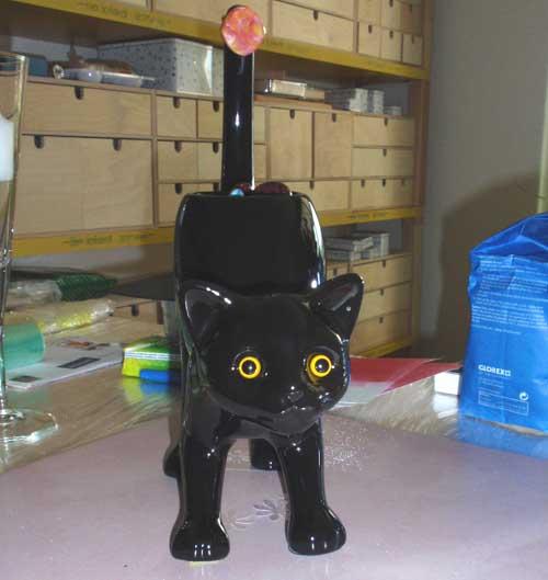 schwarze PartyLite-Katze